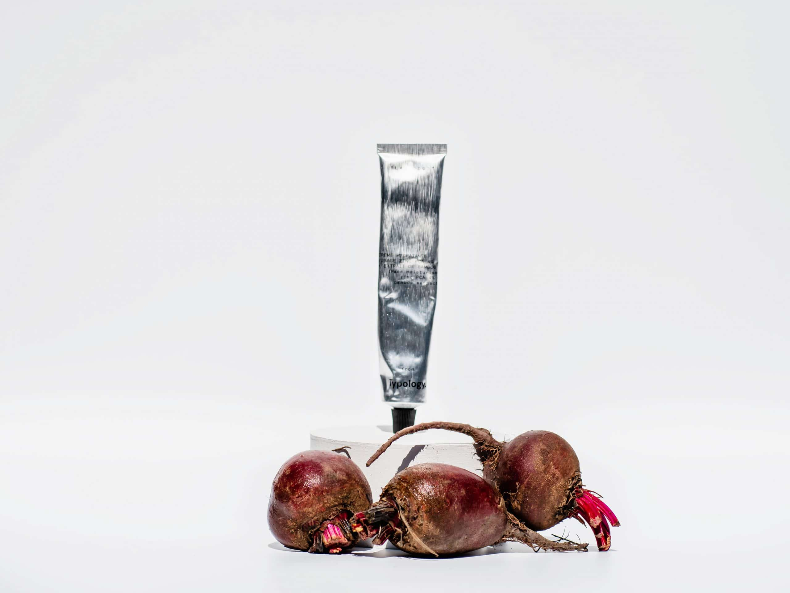 Typology zinc pca moisturizer placed with three beetroots